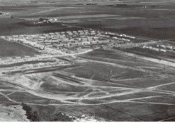 historical aerial view of downtown in 1960's largely undeveloped fields