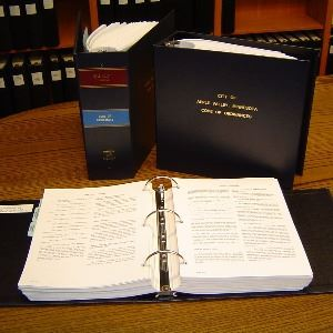 code book open on desk with other code books in background