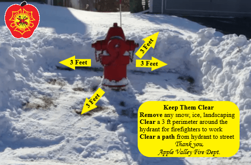 A red hydrant with a three foot radius of snow removed