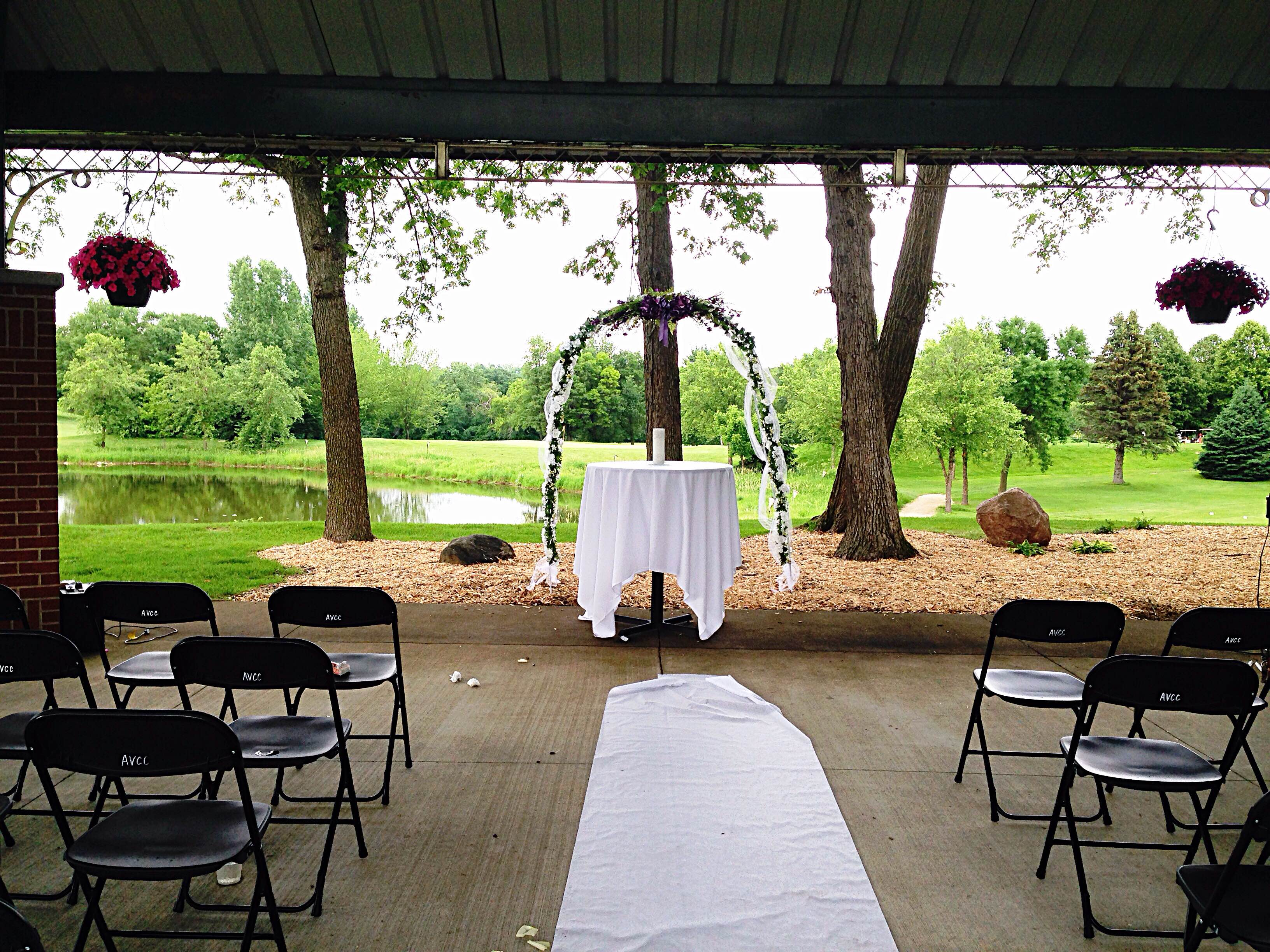 outdoor shelter set-up for wedding with golf course in background