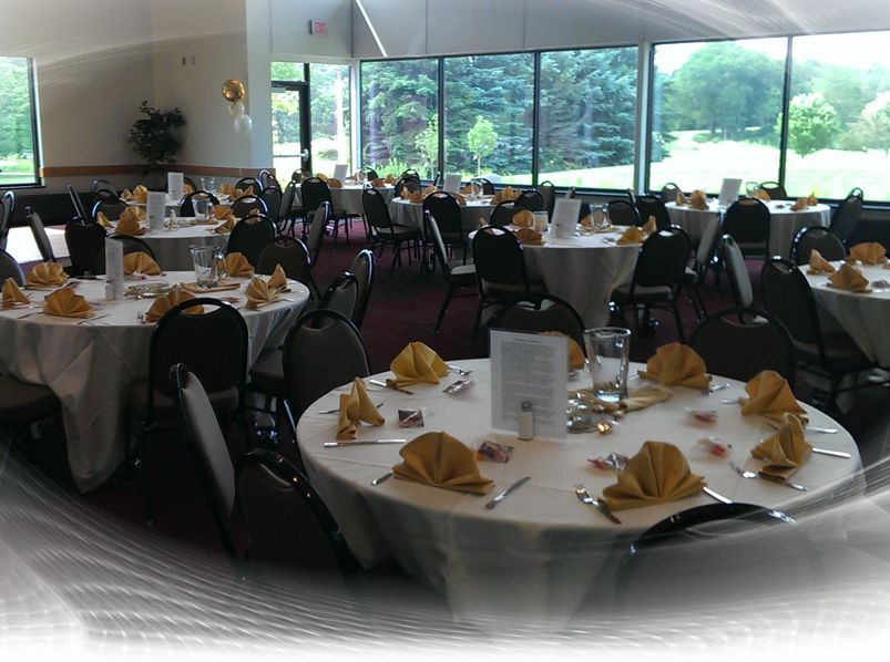Formal setting of tables, linens, goblets, and centerpieces