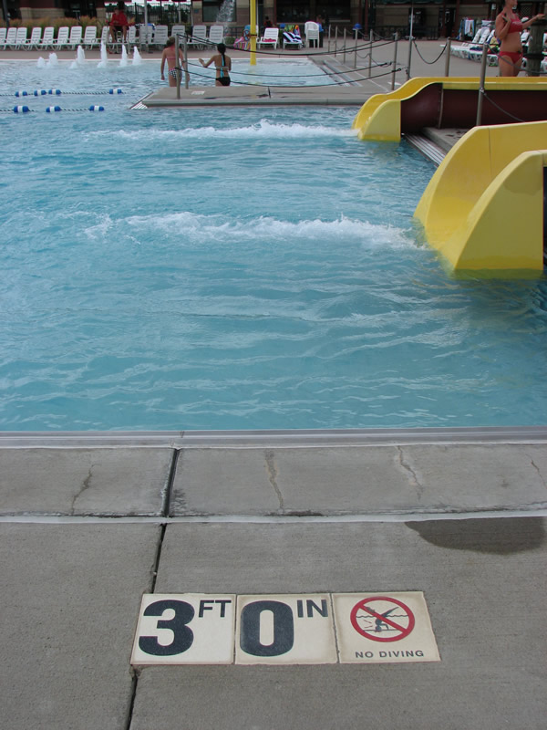 Three foot water depth at exit of water slides