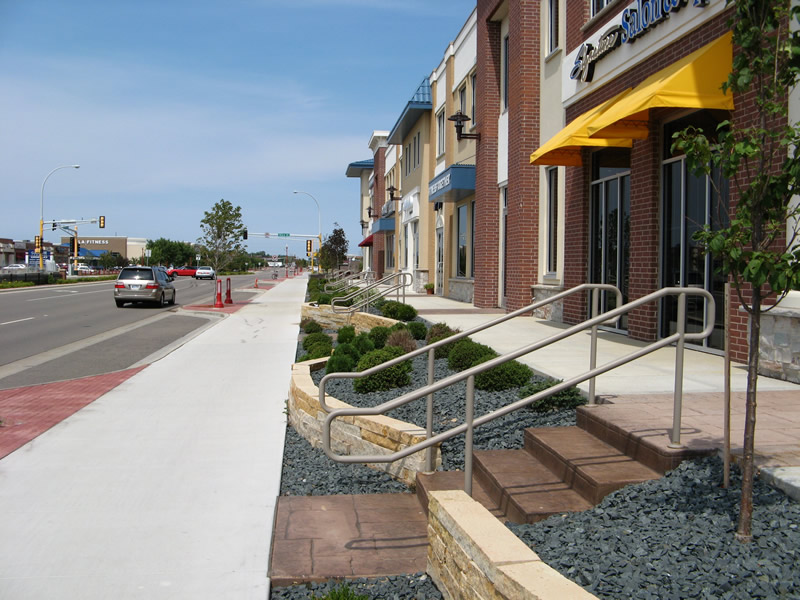Shops entrances and sidewalk along street