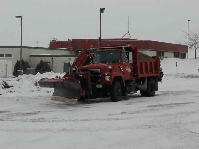 Snow plow in snow removal operation