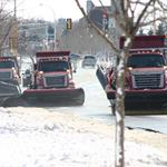 Three snow plows in a row