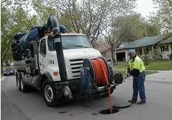Vactor truck cleaning sewer